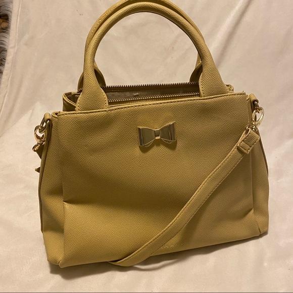 Tahari Handbags - Beige Tahari purse. NWOT.